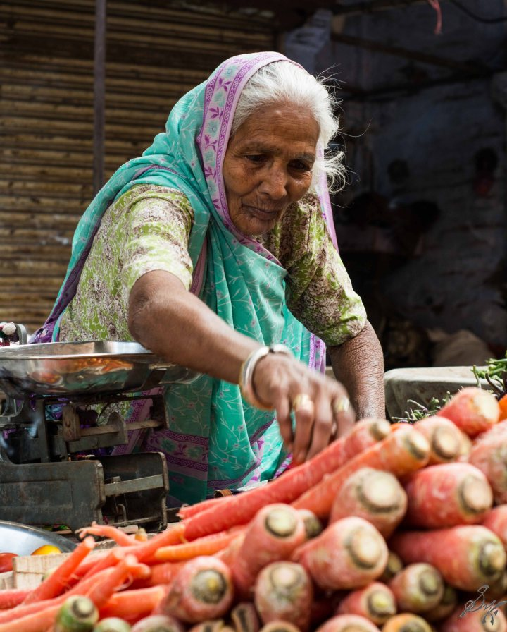 Old lady selling carrots