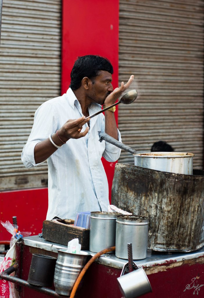 Tea seller tasting tea before serving to customers