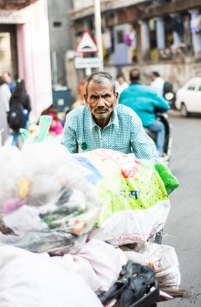 Garbage collector on his early morning routine rounds