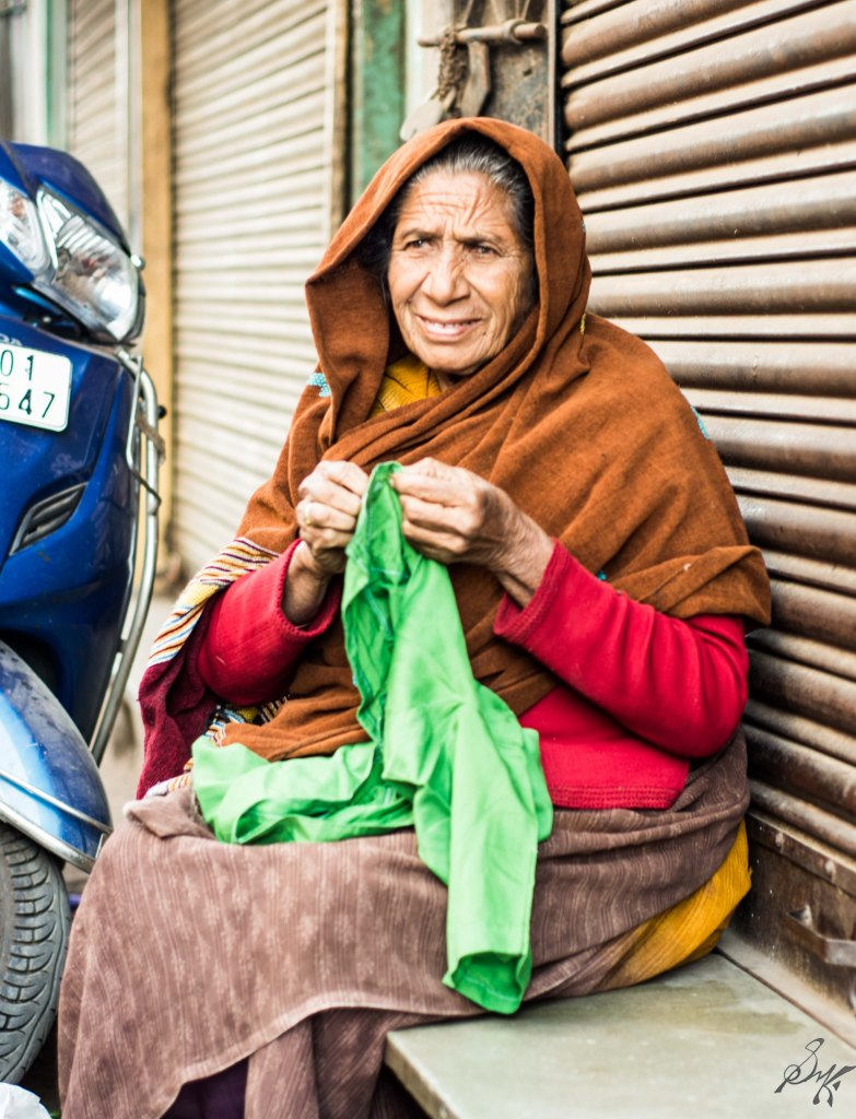 Old lady sewing some cloth in Ahmedabad, Gujarat