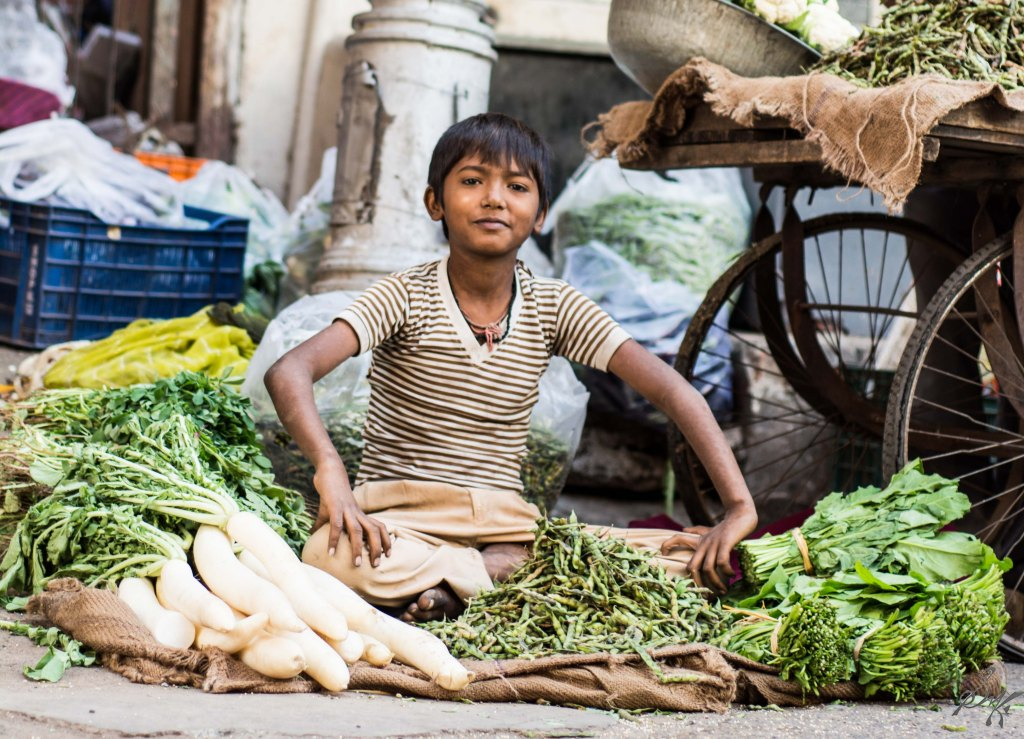 Young boy sells vegetables in Ahmedabad, Gujarat
