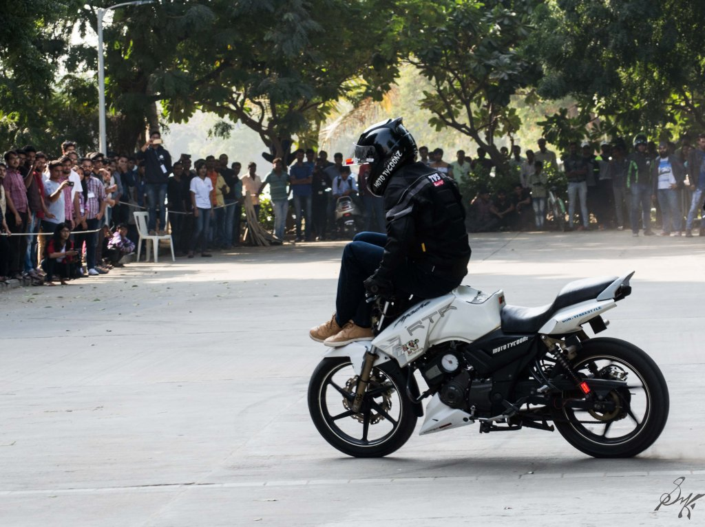 Bike stunt sitting on handle bars