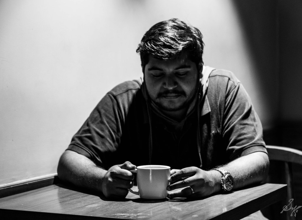 Man thinking with a cup of coffee
