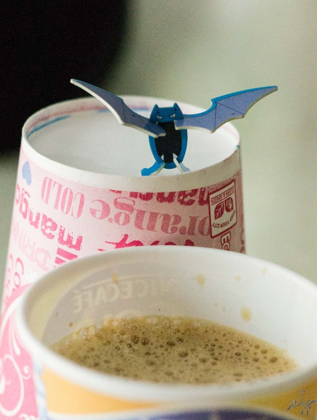 Pokemon Golbat looming over a cup of coffee