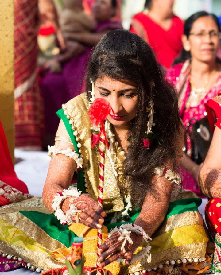 The bride doing the rituals