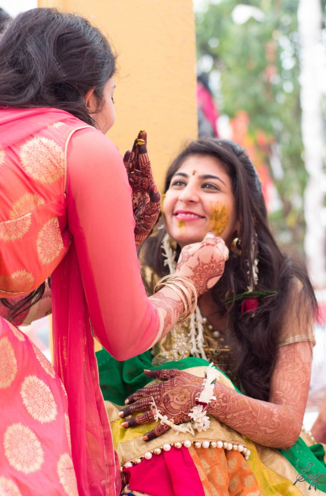 Bride's sister applies turmeric, rituals