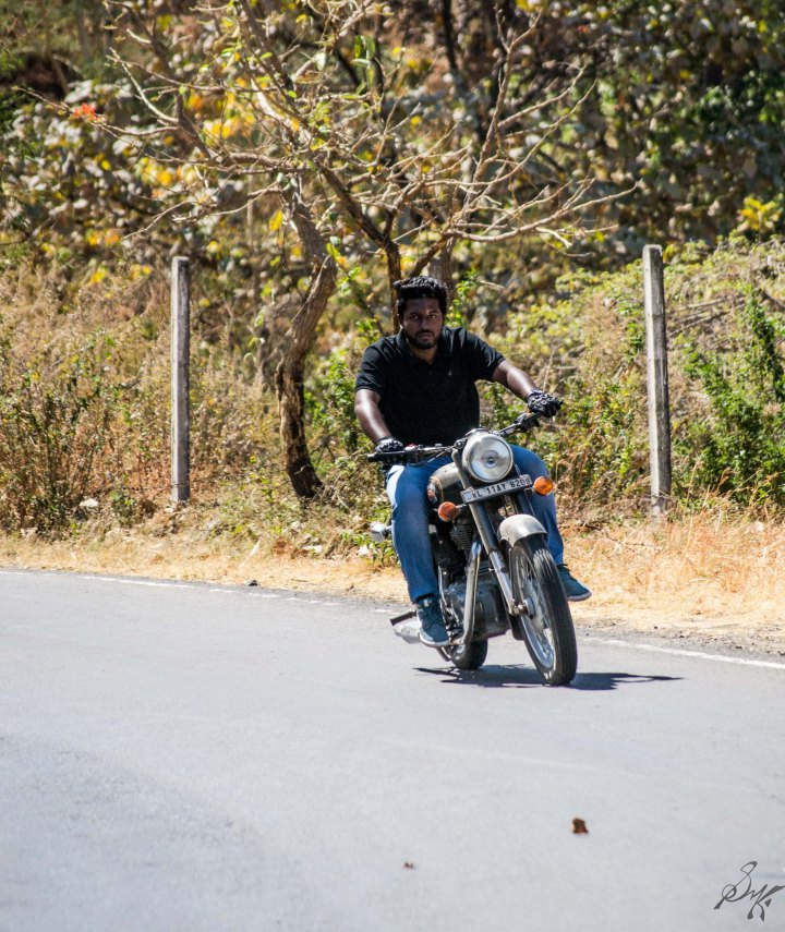 Man on Royal Enfield Bullet taking a turn