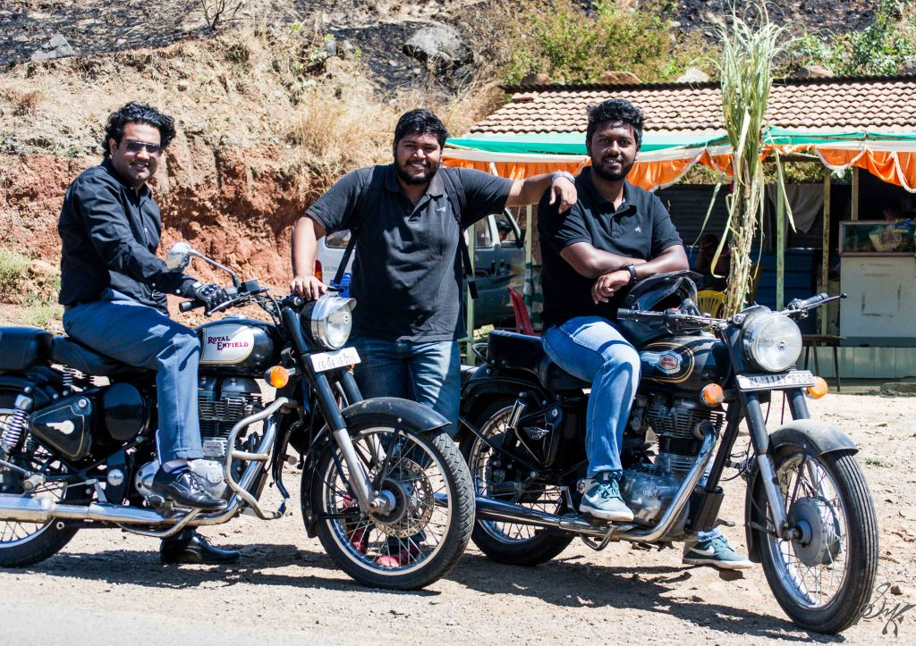 Three friends posing with their bikes