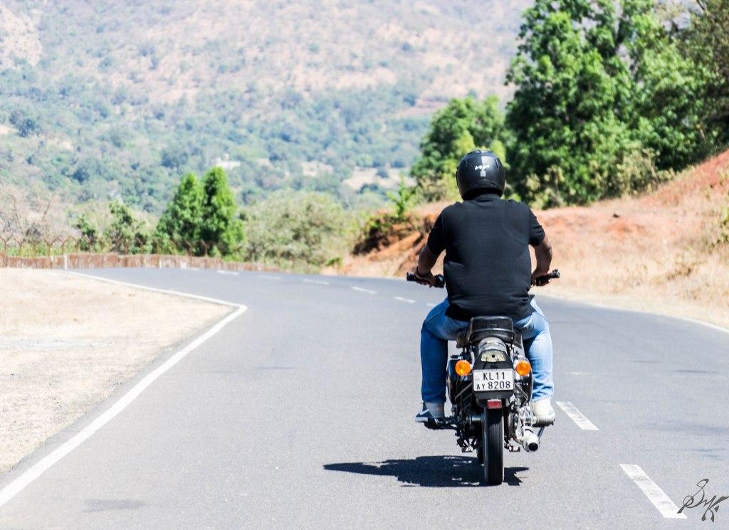 Man on a bike in an empty road