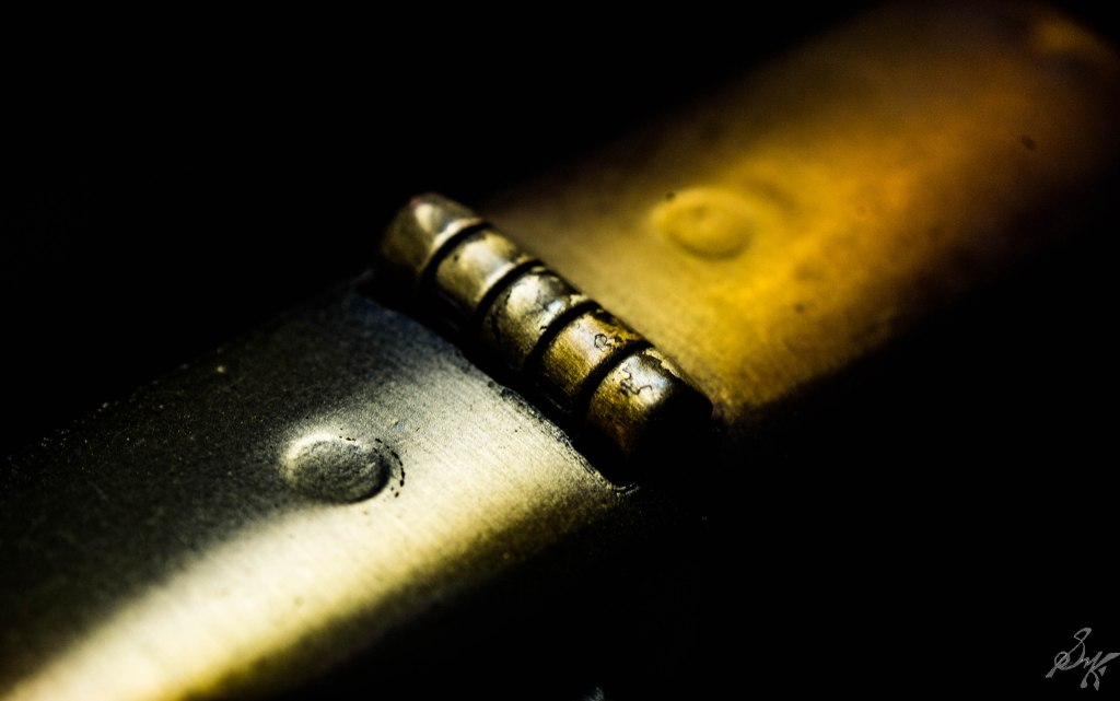 macro close up of the hinge of a zippo lighter