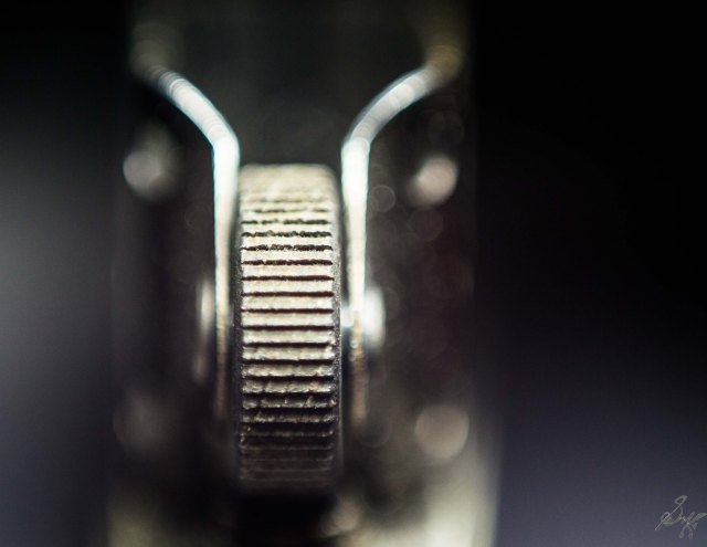 macro close up of the striking wheel of a zippo lighter