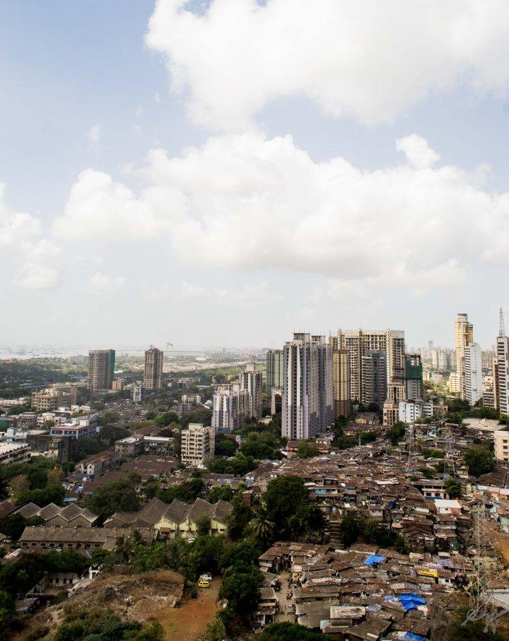 slums and high rise buildings sea ships and the sky, Mumbai, India