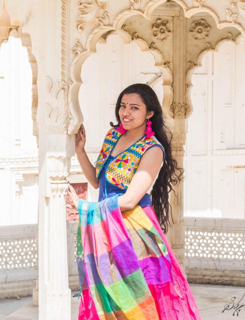 Girl posing with a column at City Palace, Alwar, Rajasthan