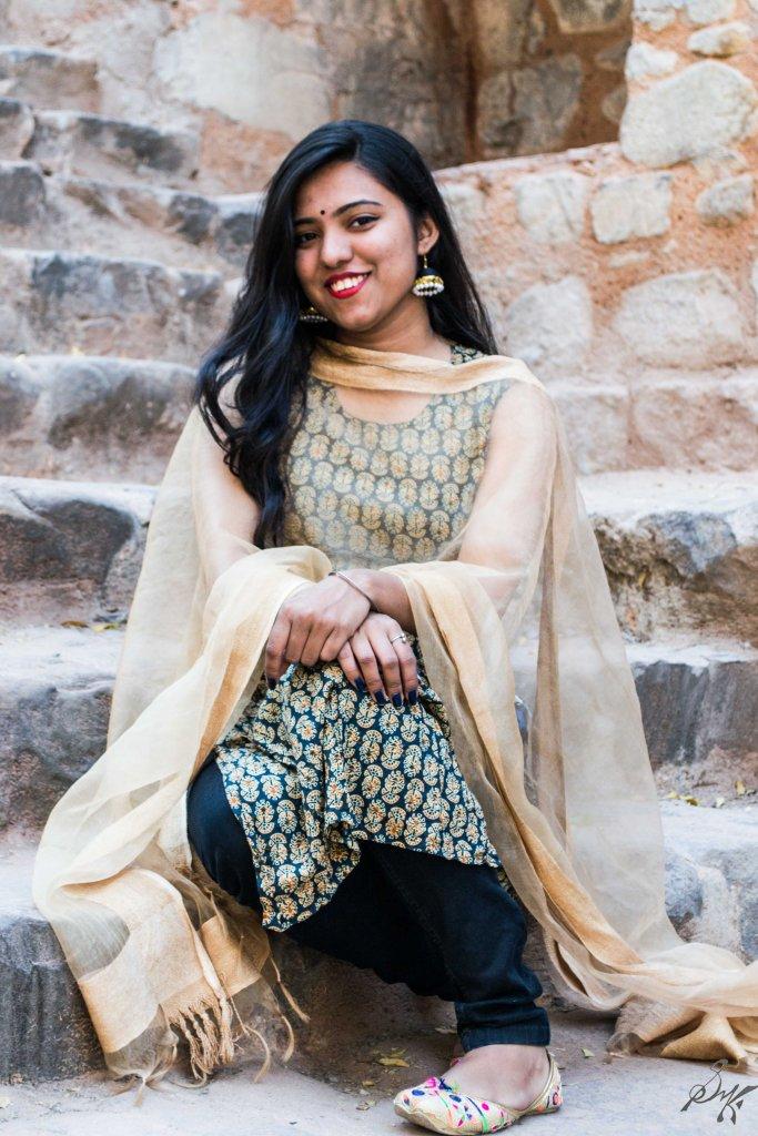 Girl sitting on stairs with a smile, Agrasen ki baoli, New Delhi, India