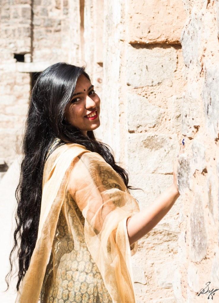 Girl looking back with a smile, Agrasen Ki Baoli, New Delhi, India