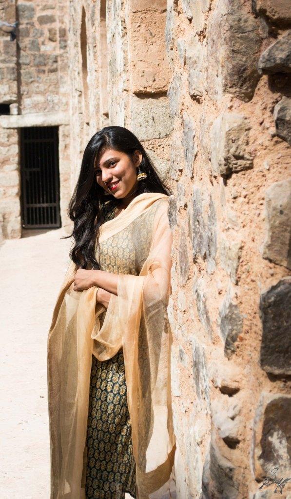 Girl resting on a wall with a smile, Agrasen Ki Baoli, New Delhi, India
