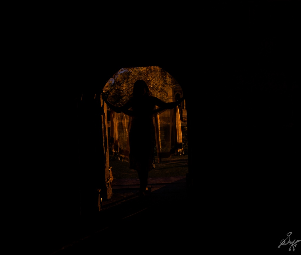 Girl standing at the doorway of Lodi Gardens, New Delhi, India