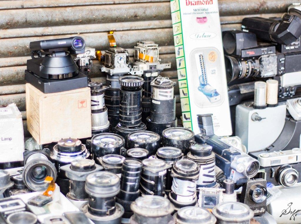 Various camera lenses for sale on the roadside