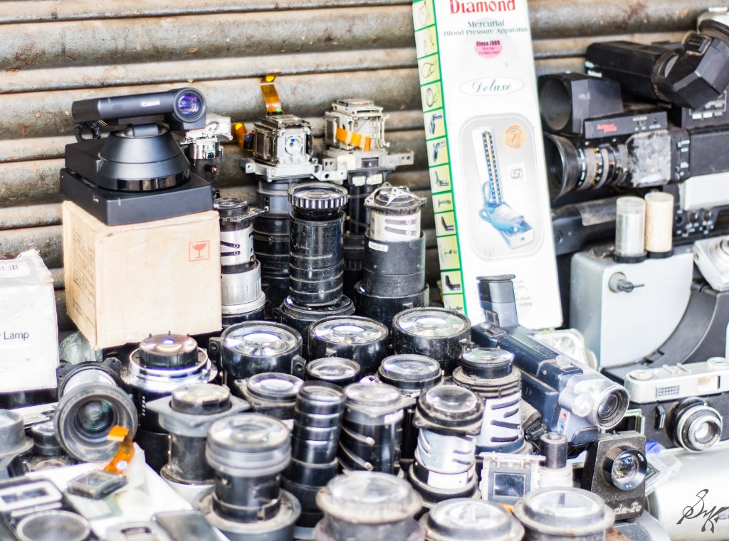 Various camera lenses for sale on the roadside