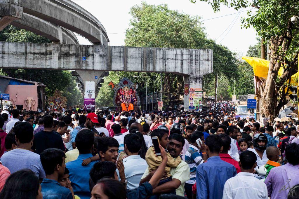 Dense crowd awaits the arrival of the Ganesh Idol for Visarjan