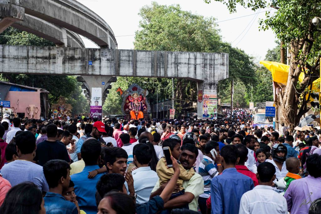 Dense crowd awaits the arrival of the Ganesh Idol for Visarjan