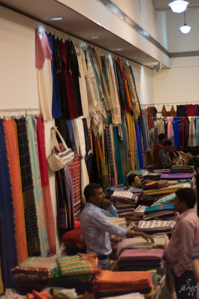 Various sarees and fabric on display