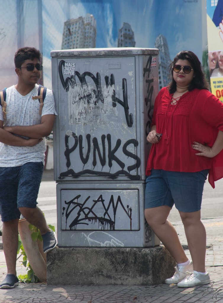 Friends posing with a graffity
