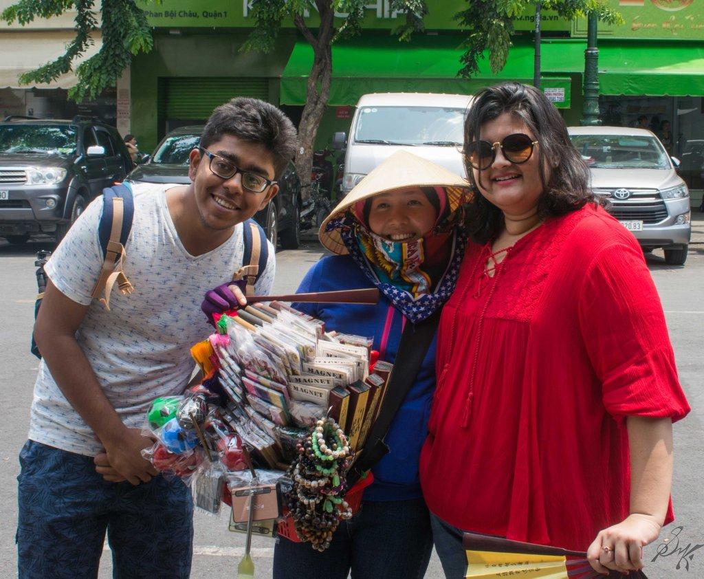 Friends posing with a local lady. Saigon