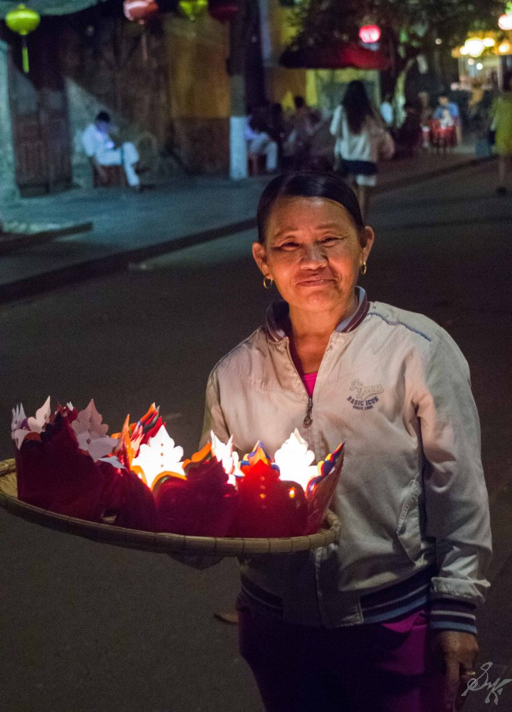 A lady selling the floating lamps, Hoi An, Vietnam