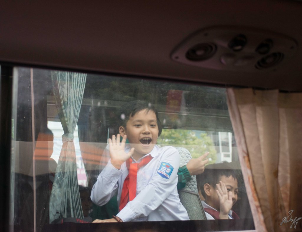 Happy kids waving at us, Hanoi, Vietnam
