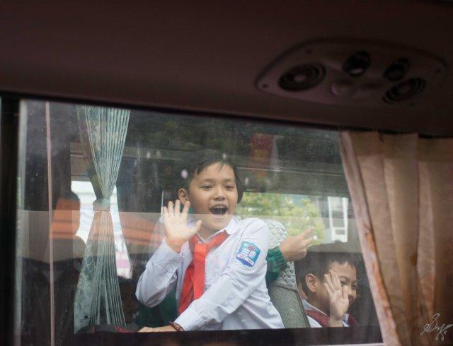 Happy kids waving at us, Hanoi, Vietnam