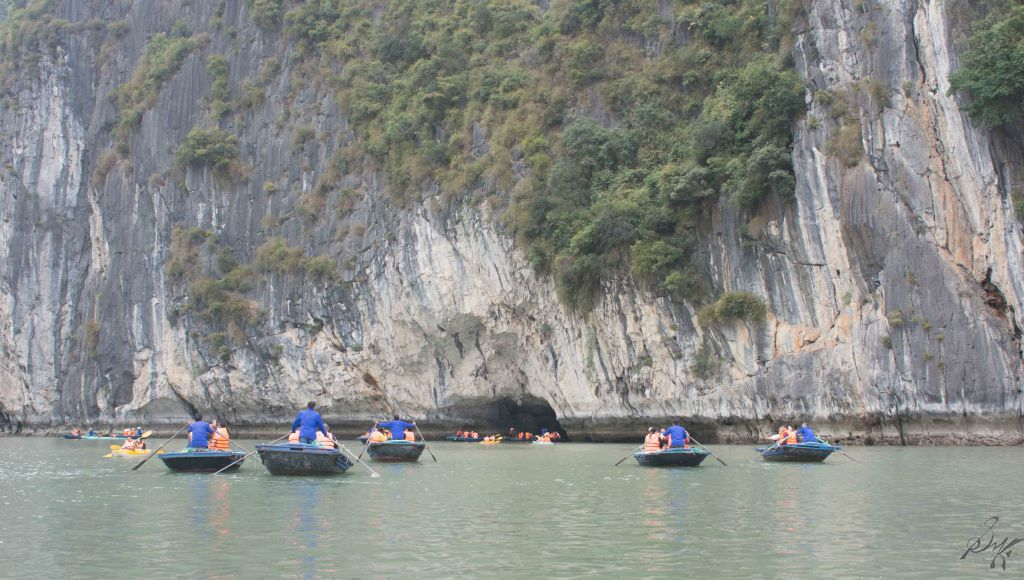 Boats and kayaks exploring, Ha Long Bay, Vietnam