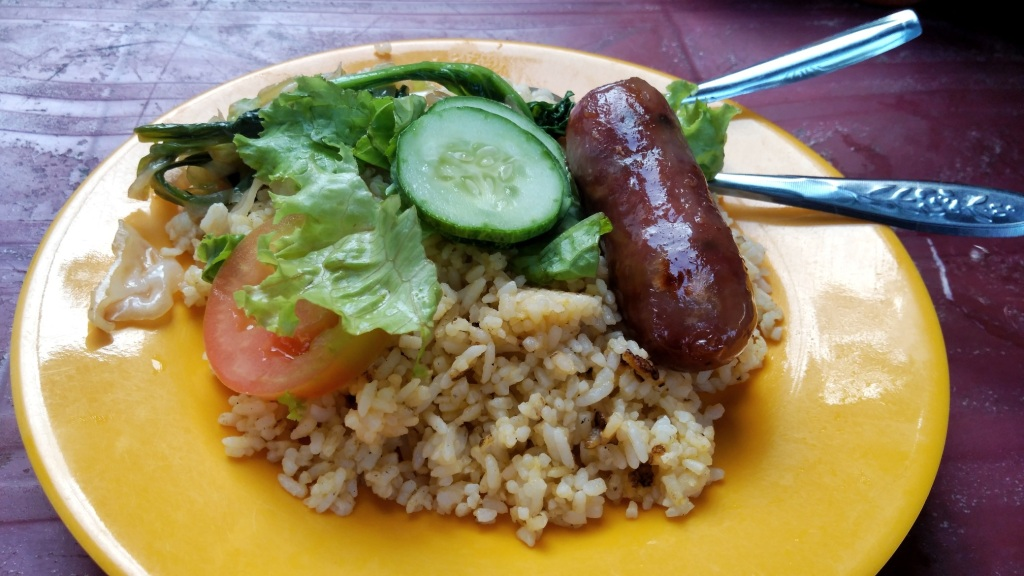 Sticky rice, vegetables and a pork sausage